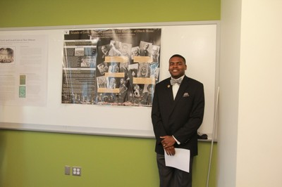 English graduate student Earl Brooks presents his research